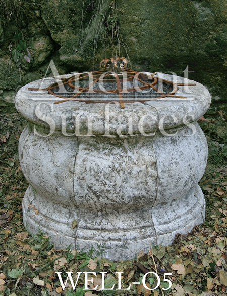 Ancient tea pot shaped reclaimed stone well head with old hand twisted metal work