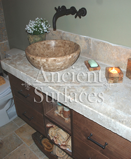 "Antique thick Limestone slabs milled at 3"" in thickness used as vanity counter tops in a powder room, salvaged from the bottom of farm house foundations"