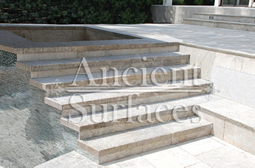 "Antique thick Limestone slabs milled at 3"" in thickness used as landscaping stairs and pool and spa stairs, salvaged from the bottom of farm house foundations"