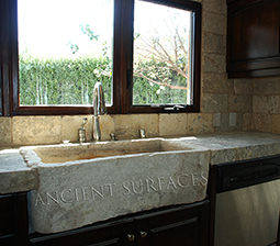 "Antique thick Limestone slabs milled at 3"" in thickness used as vanity counter tops in a master bathroom, salvaged from the bottom of farm house foundations"
