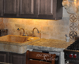 "Antique thick Limestone slabs milled at 3"" in thickness used as a bath tub surround in a master bathroom, salvaged from the bottom of farm house foundations"