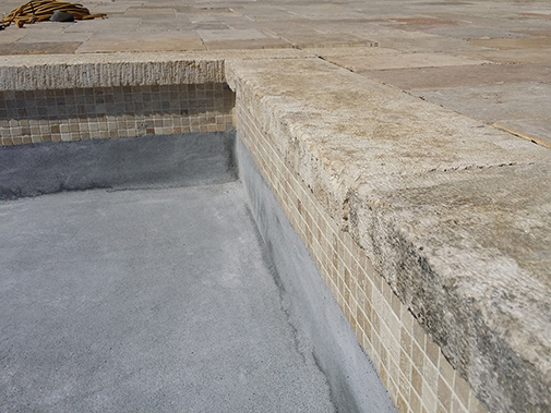"Antique Stone Pool Coping Slabs Milled at 2.5"" in Thickness Installed in a pool in a Custom Home in Newport Beach"