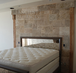 Kronos limestone cladding on the back wall of a master bedroom headboard