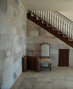kronos limestone cladding used on the foyer entry wall and main staircase of an Italian style Villa