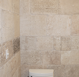 Kronos Limestone cladding used in a master bathroom shower floors and walls