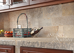 Biblical Stone used on a backsplash of a Tuscan farmhouse kitchen