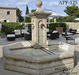 Antique rounded pool fountain from the 16th century with a middle pedestal and urn
