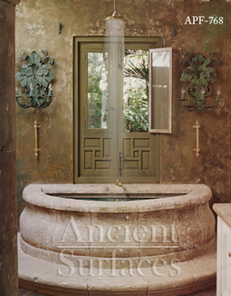 antique fountain transformed into a stone shower tub