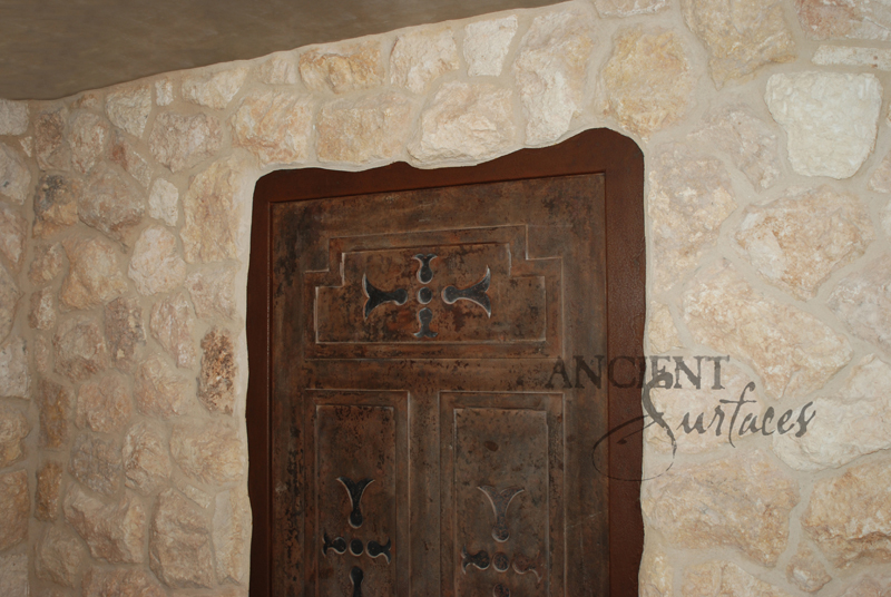 umbrian limestone cladding used on a kitchen wall cladding in a wine cellar
