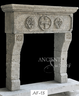 An impressive stone fireplace with a carved panel