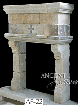 an important example of a reclaimed medieval era limestone fireplace mantle available in our local stock