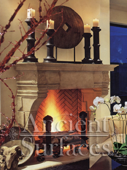An elegant stone surround installed with a hearth and herringbone bricks inside the box
