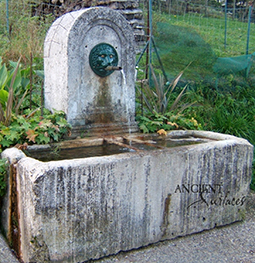 A beautiful 17th century antique reclaimed limestone wall fountain salvaged from the south of France