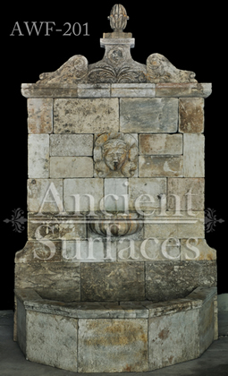 Antique reclaimed limestone wall fontain over 400 years old, reclaimed from the south of France