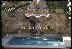 Ancient Reclaimed Stone Wall Fountain with an Angel Cherub Baby Face carved into the back of the fountain. Provenance, the south of France