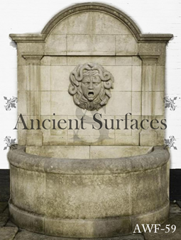 An antique limestone wall fountain with a medusa head mask reclaimed from Northern Europe circa 18th century