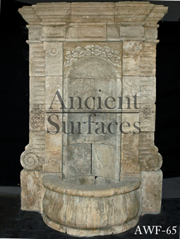 A 17th century antique French stone wall fountain salvaged from the south of France