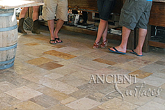 Antique reclaimed 'Arcane Stone' pavers salvaged from 17th centuries period homes from across the south of France and the Mediterranean European south. Installed in a old world Tuscan Italian style kitchen