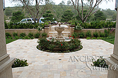 Ancient Reclaimed 'Arcane Stone' pavers salvaged from 17th century era homes, villas and farmhouses from sleepy southern European towns and villages. In this picture this limestone is shown installed on front yard of this picturesque coastal Mediterranean home. The Arcane Stone is perfect for all types of external and internal weather conditions and traffic volumes.