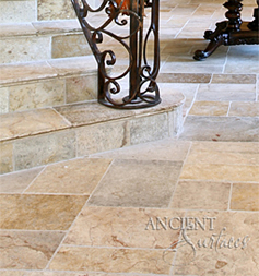 Antique reclaimed 'Arcan Stone' flooring pavers installed although this French countryside style home