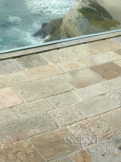 Ancient reclaimed Biblos Stone pavers shown installed on a kitchen floor in Rancho Santa Fe, CA