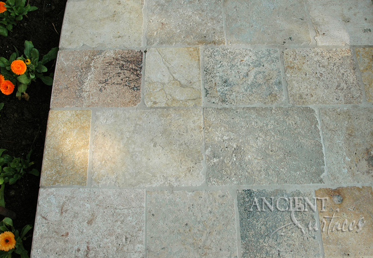 antique biblos stone flooring pavers on a stair landing in the backyard of a beverly hills
