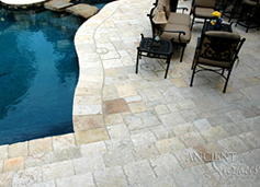 Antique Biblos Stone also named Biblical Stone, installed in a random pattern on the pool deck of a $10 million home in Newport Beach, CA