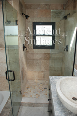 Kronos Limestone used in a master bathroom and shower floors and walls