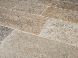 kronos limestone in situ on the wall of an old medieval courtyard of a castle villa