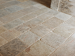 kronos limestone used on the foyer entry and main staircase of a home