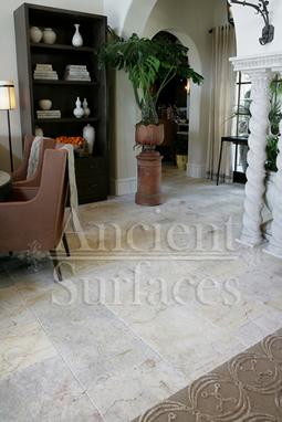 Millenium Limestone flooring wide planks installed in a living room and foyer of a mediterranean style coastal beach villa