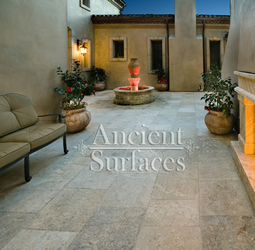 Millenium Limestone flooring wide planks installed in a front courtyard of a mediterranean style coastal beach villa