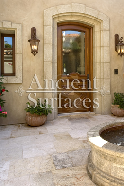Millenium Limestone flooring wide planks installed in an entry an a front courtyard of a mediterranean style coastal beach villa