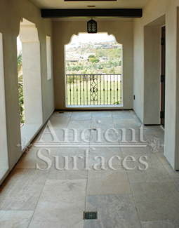 Millenium Limestone flooring wide planks installed in the patio of a mediterranean style coastal beach villa
