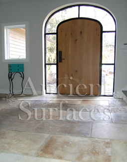 Millenium Limestone flooring wide planks installed in the entryway of a mediterranean style coastal beach villa