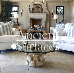 Millenium Limestone flooring wide planks installed in a living room and family room of a mediterranean style coastal beach villa