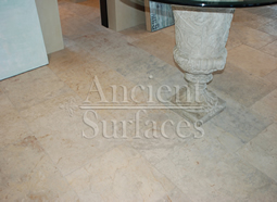 Millennium Limestone flooring wide planks installed in the courtyard of a Mediterranean style coastal beach villa.