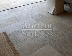 Millennium Limestone flooring wide planks installed in the livingroom of a Mediterranean style coastal beach villa.
