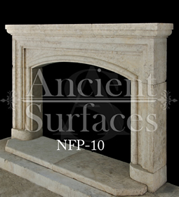 An arched stone fireplace surround carved by hand