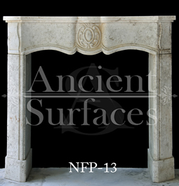 A very beautiful and simple Louis XV fireplace mantel hand carved with stone and carries many curvatures and features a nice middle motif finished with a convex leg profile