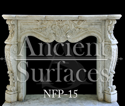 A well carved Louis XV style stone fireplace
