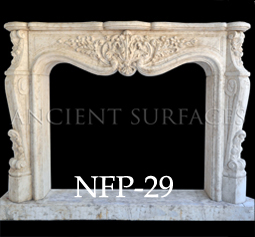 A stunning hand carved stone fireplace mantel for the great room