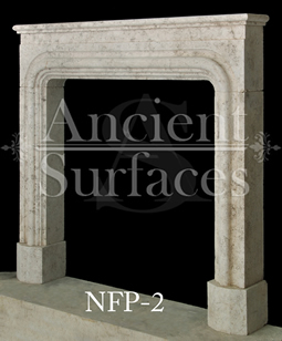 A simple Bolection fireplace hand carved out of French limestone