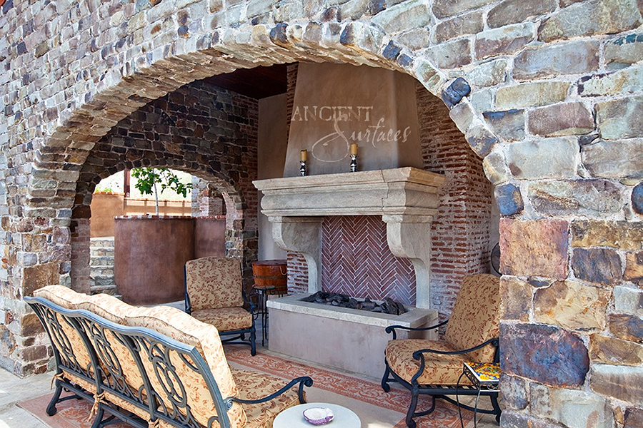New hand carved stone fireplace mantels out of french limestone by this stone fireplace has nice corbelled legs supporting a simple piece tuscan style lintel teraionfo