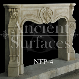 A 16th century Louis style fireplace stone mantel hand carved in France