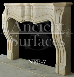 A unique French fireplace design hand carved out of limestone in an art nouveau style