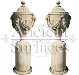 Antique Lion Headed and Draped Limestone Planter Pair