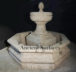 Hand carved tiered octagonal limestone pool fountain