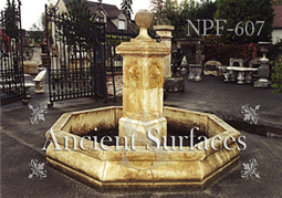 Hand carved lion headed limestone pool fountain