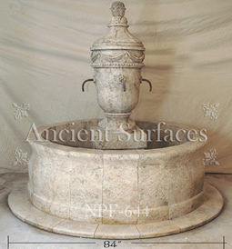 Hand carved rounded limestone pool fountain